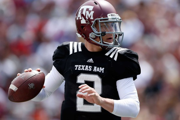 johnny-manziel-signs-so-many-autographs-because-he-got-snubbed-by-tiger-woods-as-a-kid