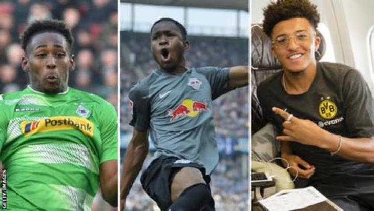 Reece Oxford (left), Ademola Lookman (centre) and Jadon Sancho (right) in Bundesliga
