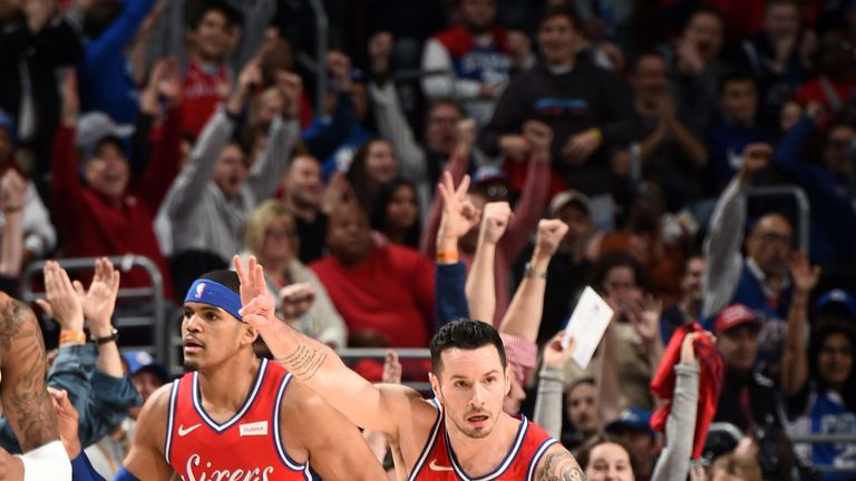 JJ Redick salutes the Philadelphia crowd after draining a three-pointer