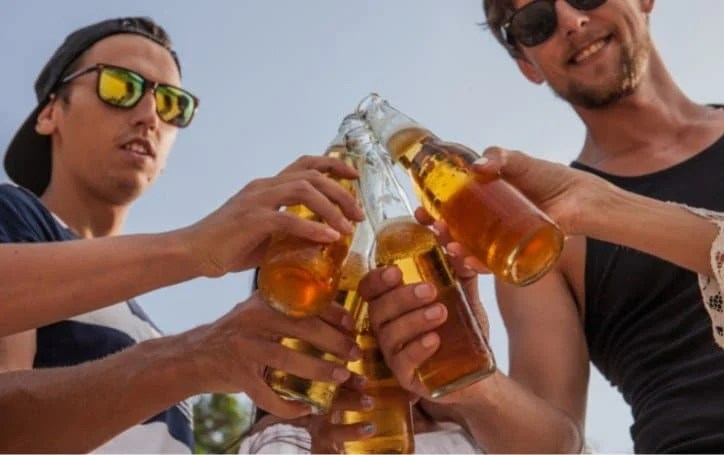 Should You Drink Beer After Running? Here's The Optimal Amount