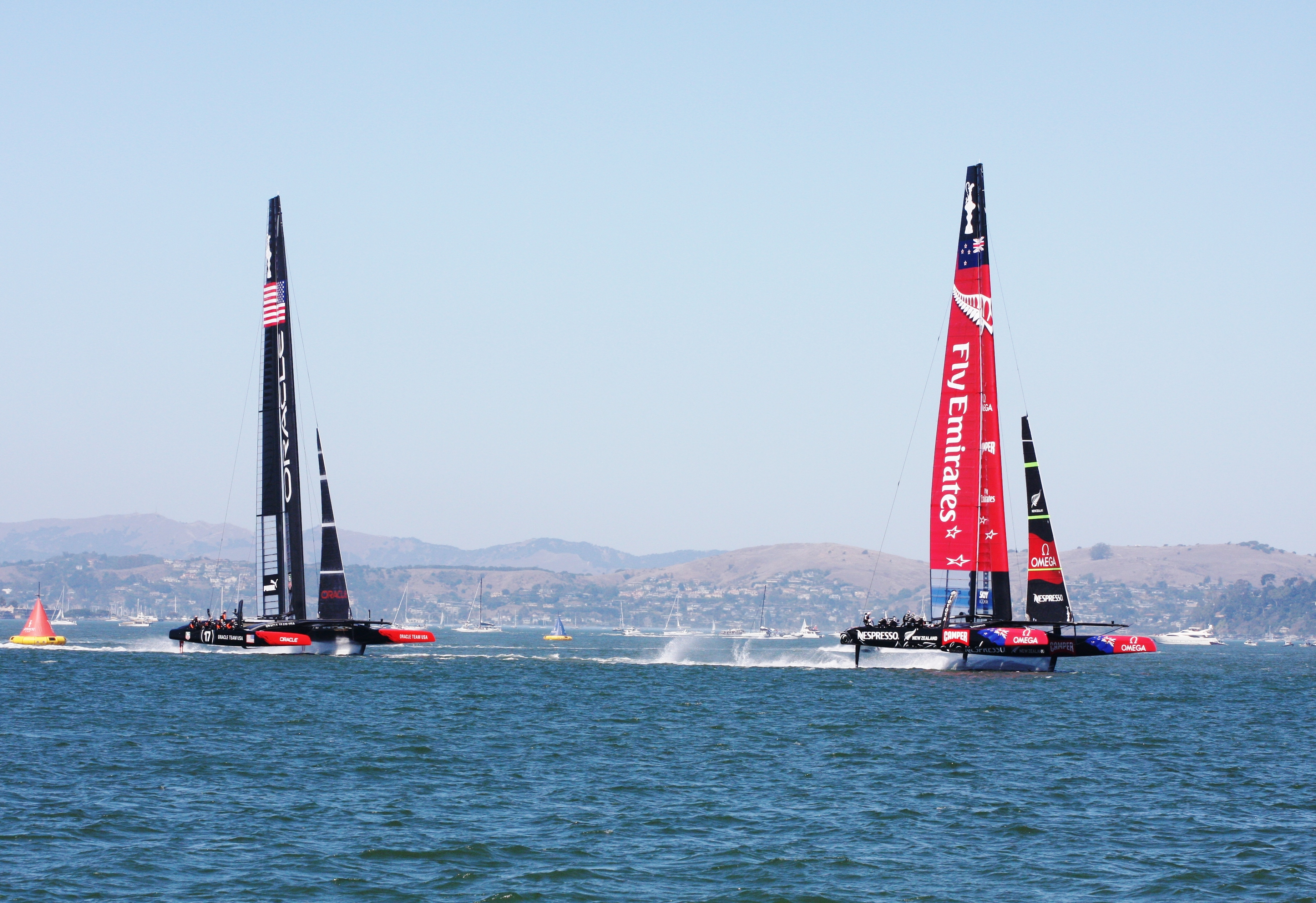 &quout;File:2013 America's Cup, race 1, mark 1.JPG&quout; by Donan.raven is licensed under CC BY-SA 3.0